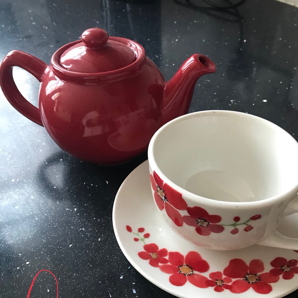 Teapot with cup and saucer