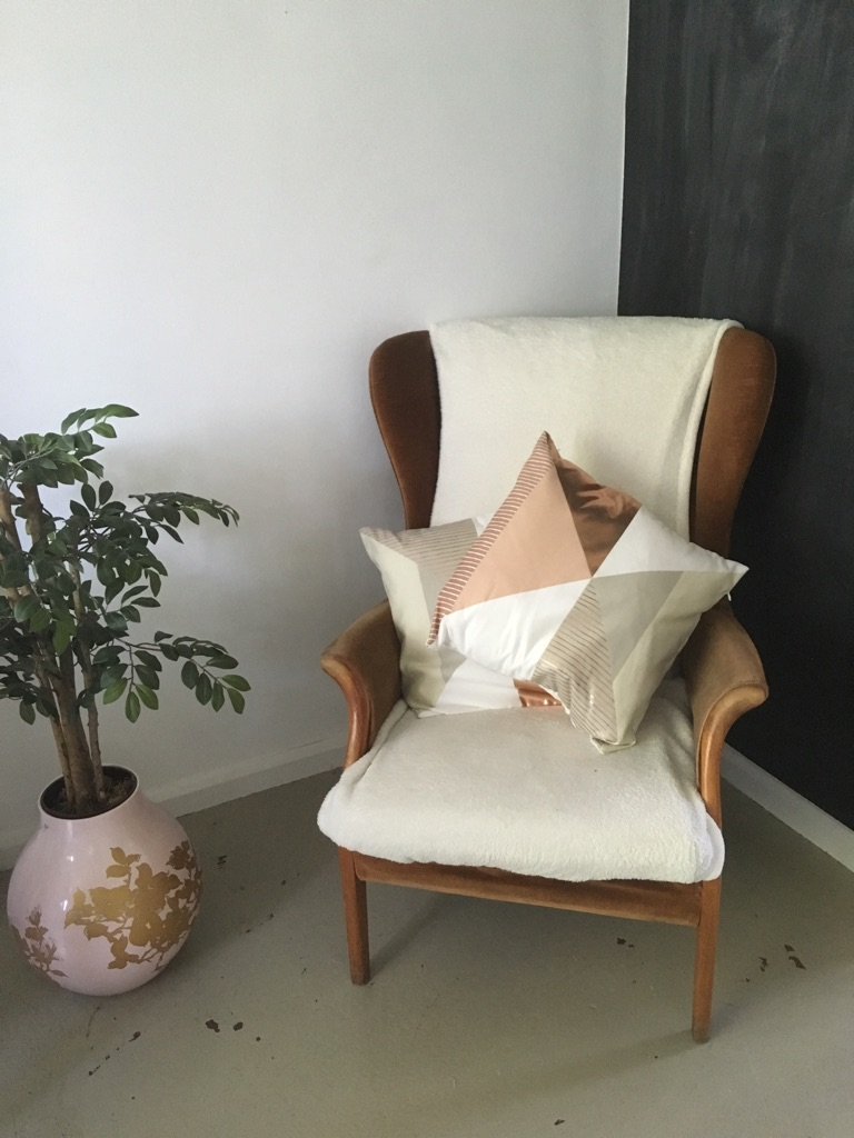 Brown vintage wingback armchair