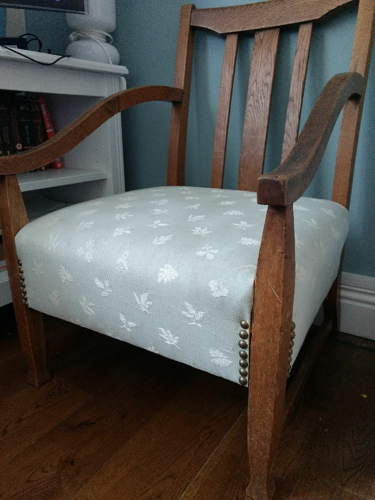 Antique wooden and upholstered low nursing chair