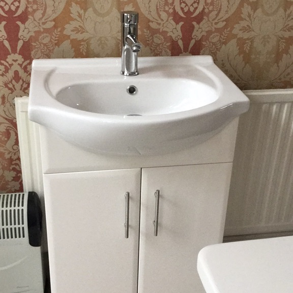 White gloss vanity unit, basin and tap