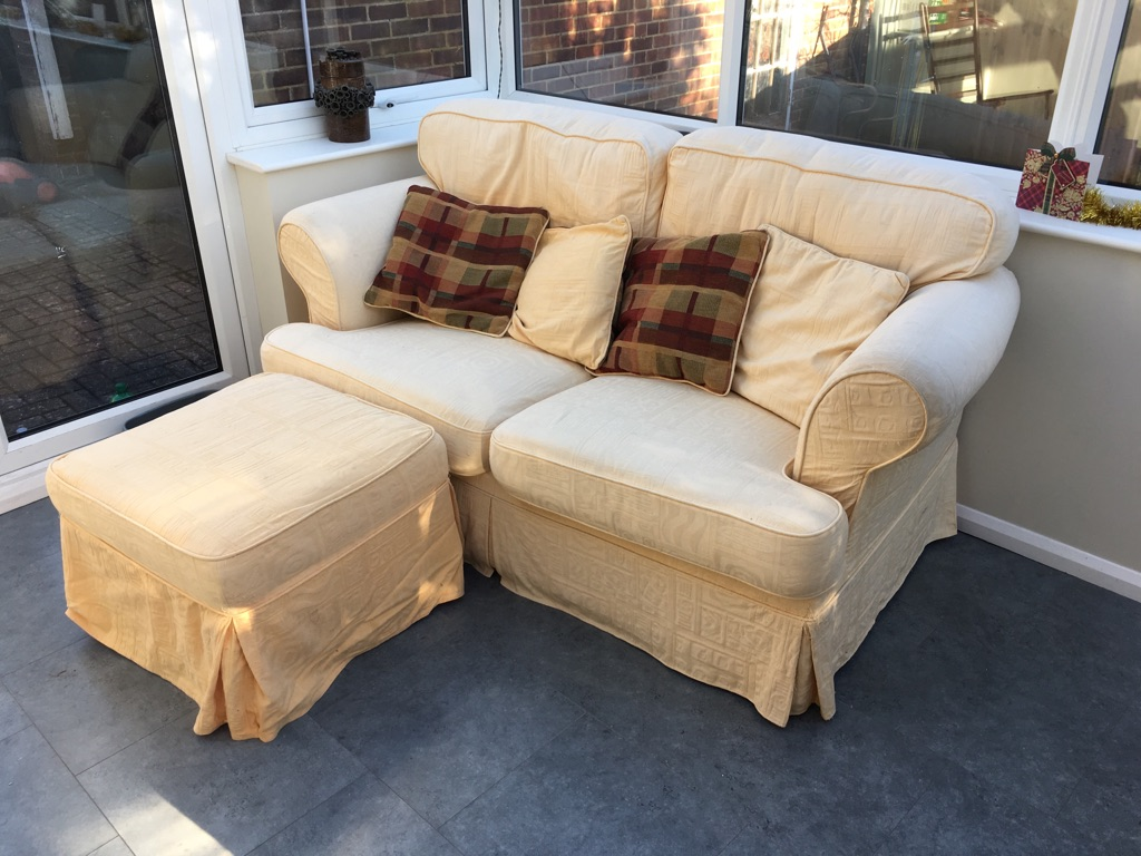 Comfy large yellow two seater sofa w/ pouffe and cushions