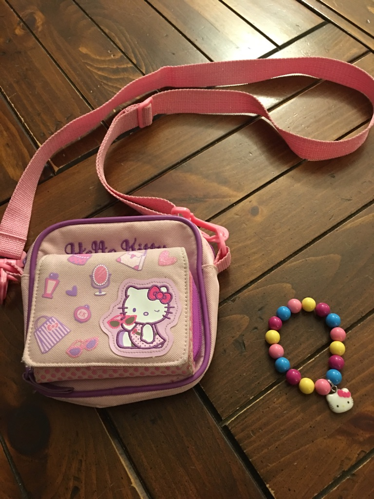 Hello kitty purse with wallet and a bracelet