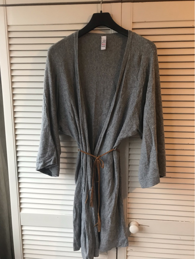 Ladies gray long sleeved wrapped around cardie  with belt.
