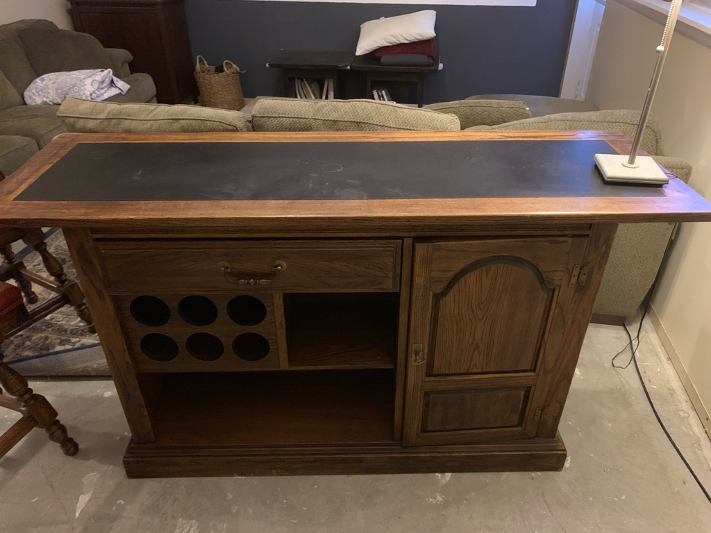 Wood bar with two barstools
