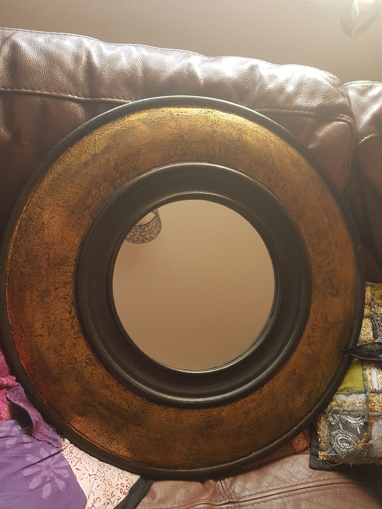 Large wooden and gold leaf circular mirror
