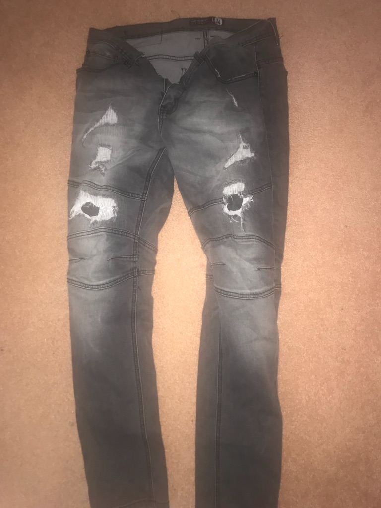 black distressed moto jeans
