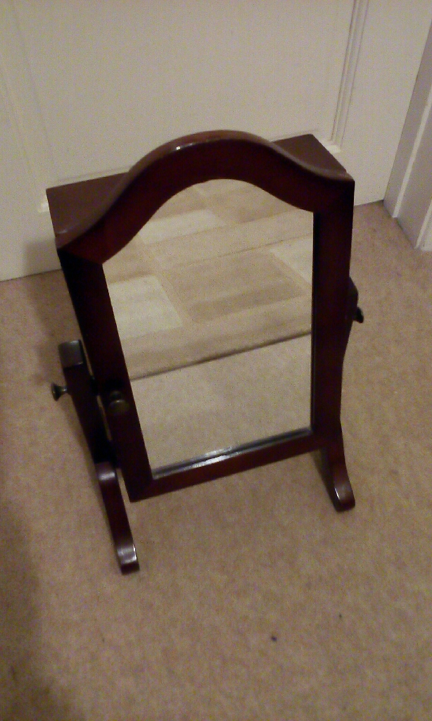 Dressing table mirror with cupboard