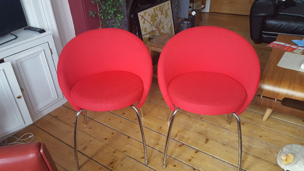 2 stylish red office chairs for sale