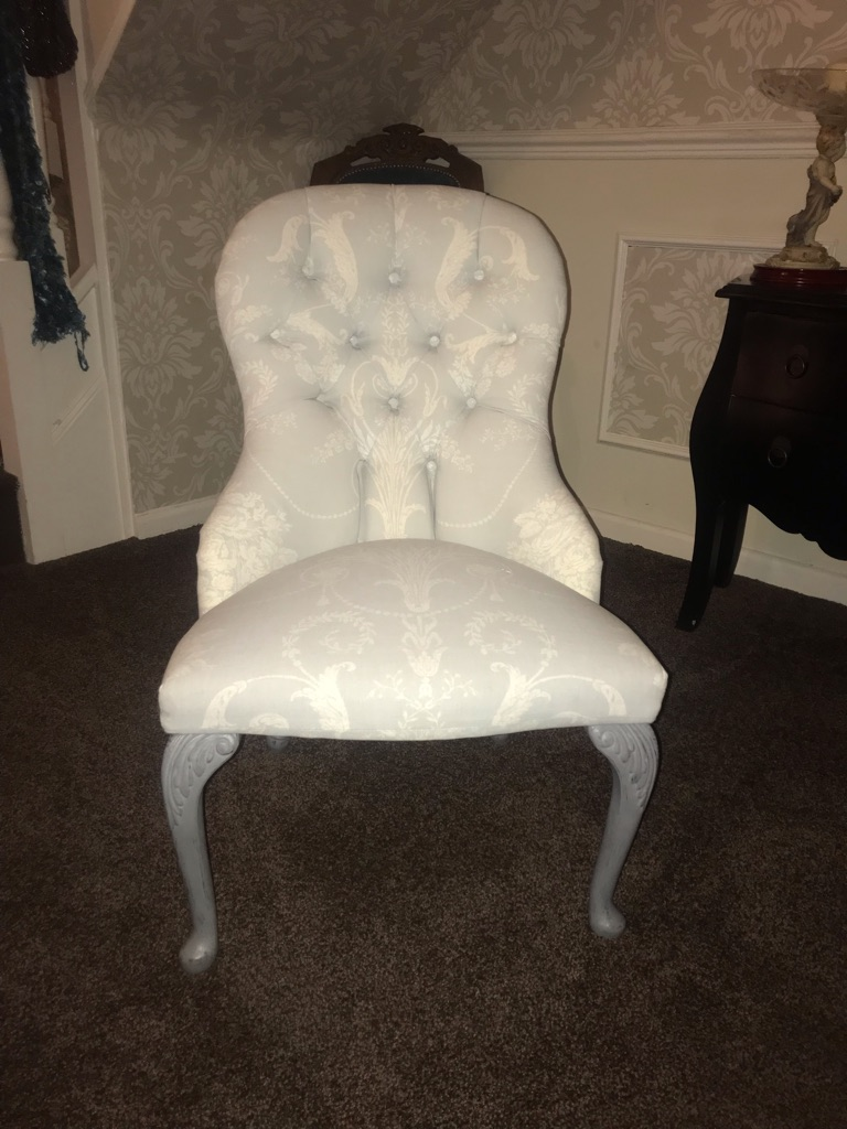 Small buttoned chair
