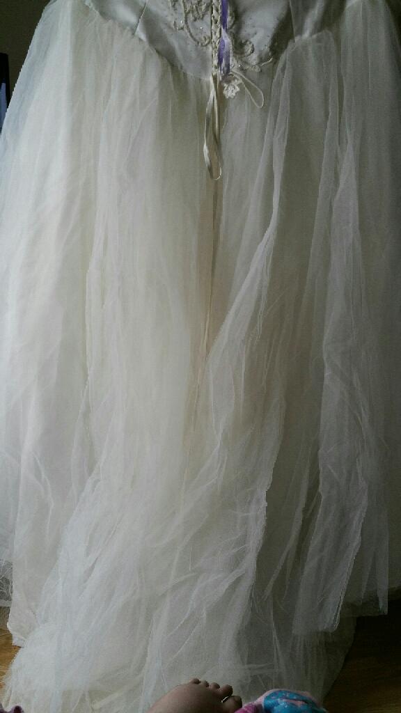 Size 30 wedding dress used needs bottom cleaning on it