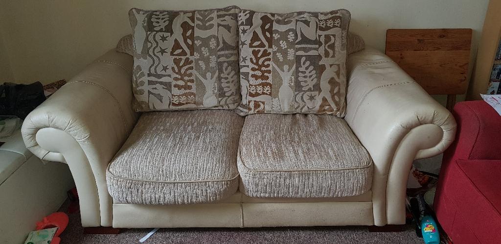 Cream leather and fabric sofa