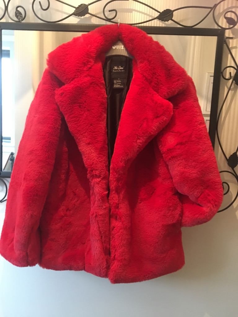 Red fur Jacket never been worn £15 & black poncho with fur trim also new & never been worn £6
