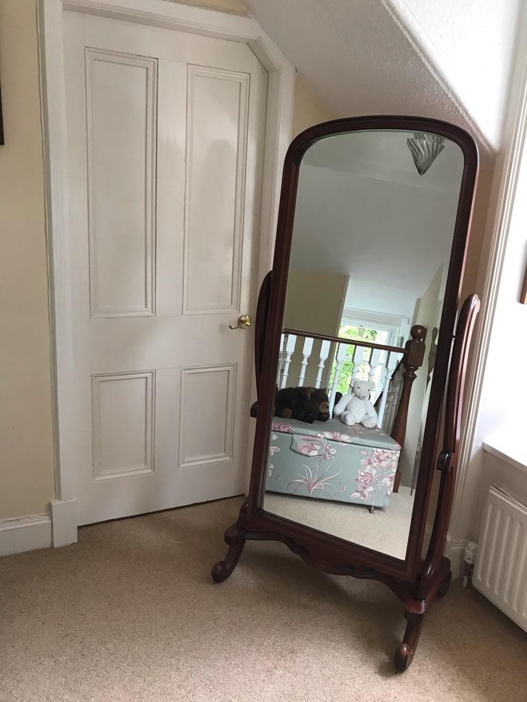 Mahogany free standing mirror.