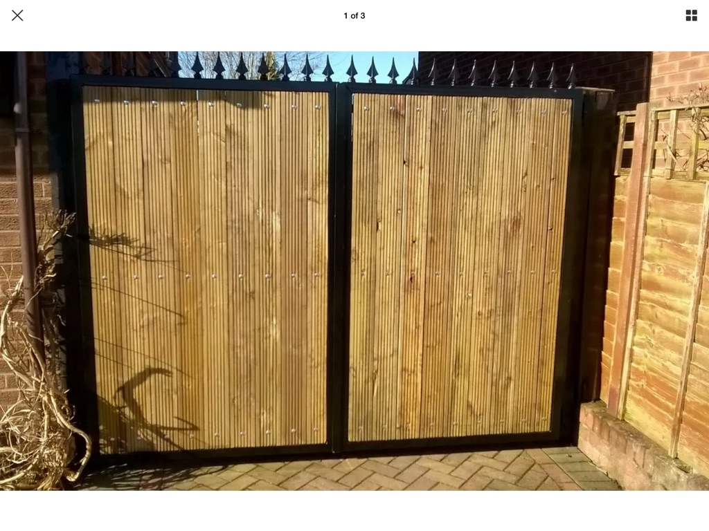 Metal framed gate with wooden infill