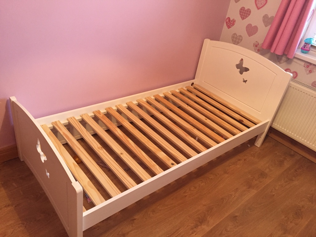 White wooden butterfly bed frame with storage drawer