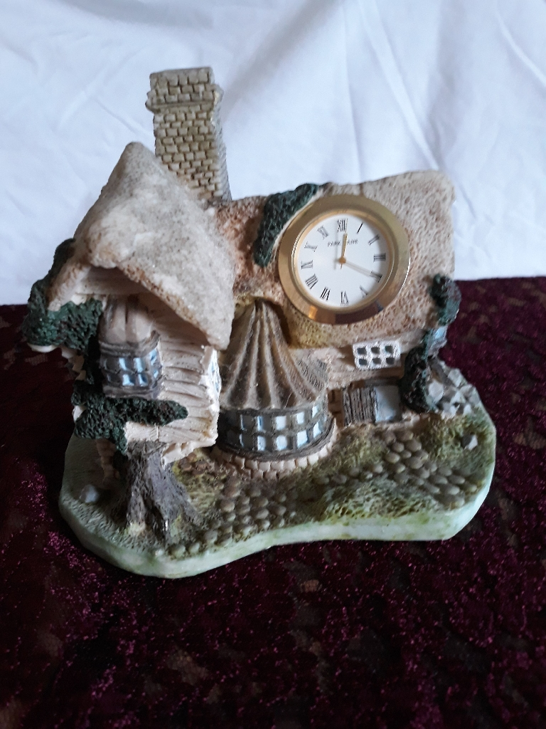 Cottage ornament with clock