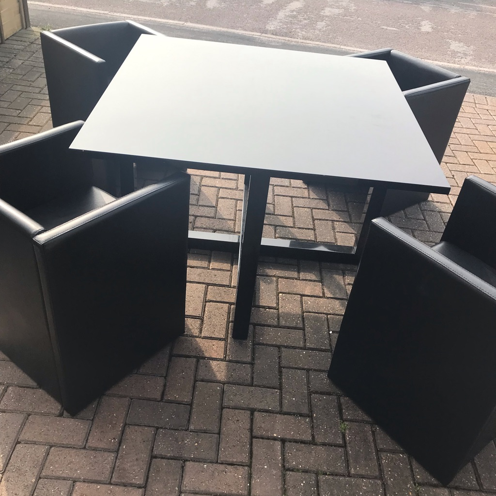 Space saving black high gloss table and chairs
