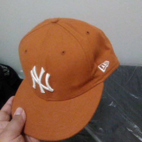 Orange Yankee hat