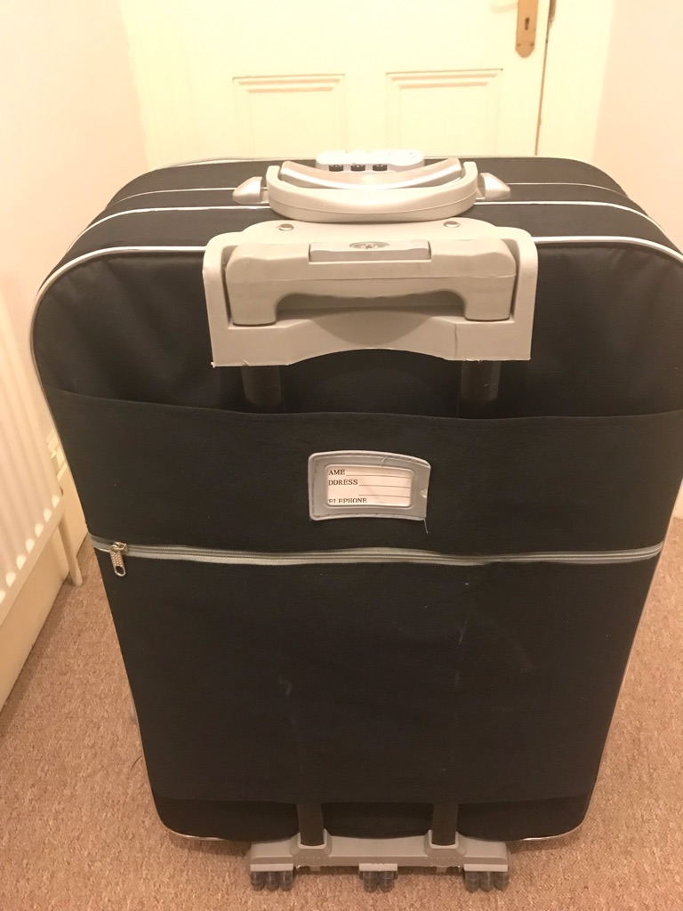 Large suitcase with a combination lock