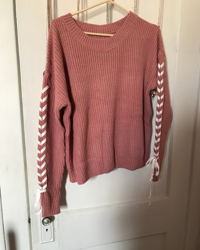 Women's pink and white sweater the size is M and will be good for L