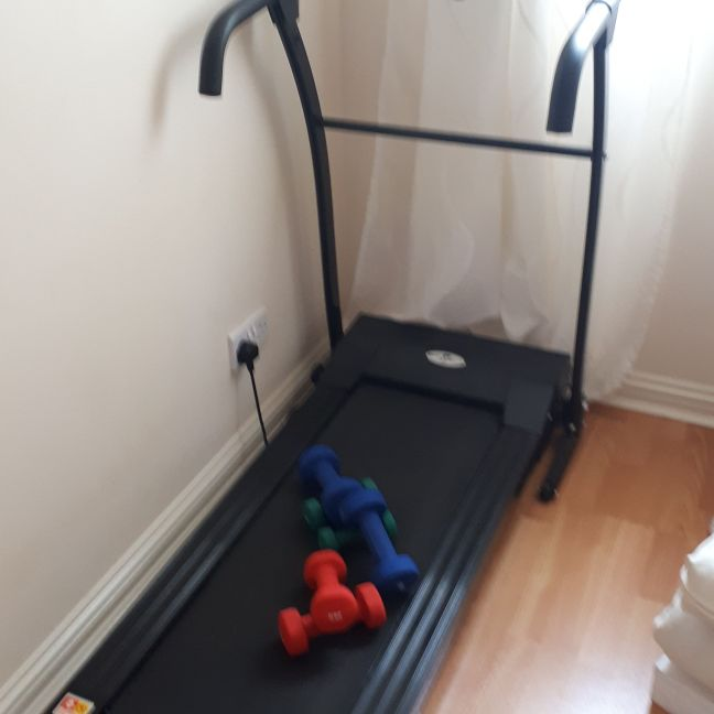Nero sports folding treadmill and weights
