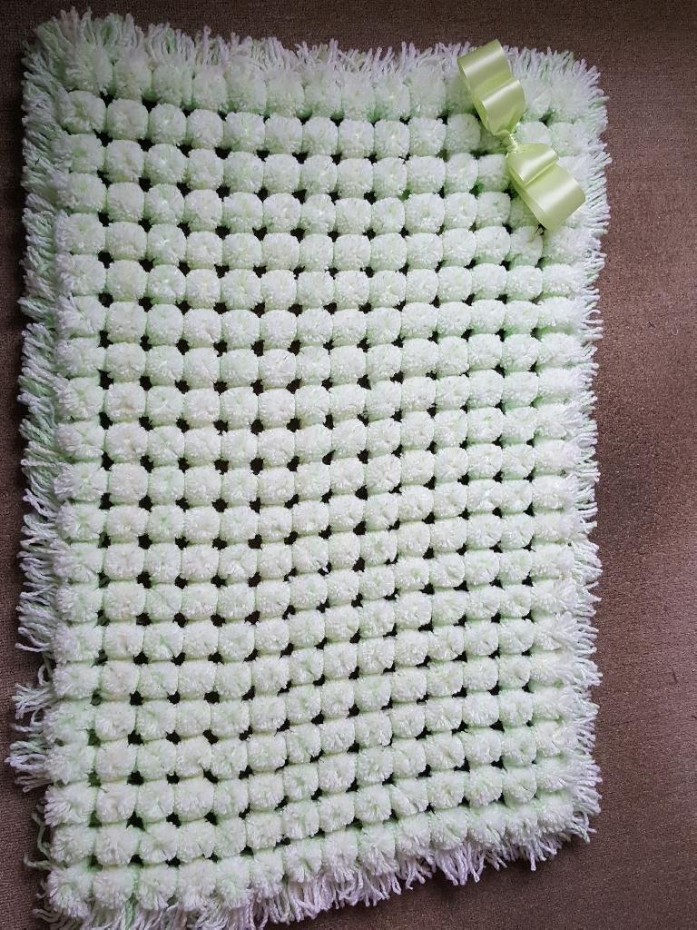 Handmade large  pom pom blanket for pram and Moses basket