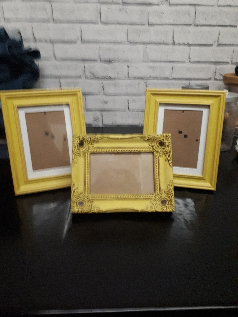 Vintage look picture frames plus candle