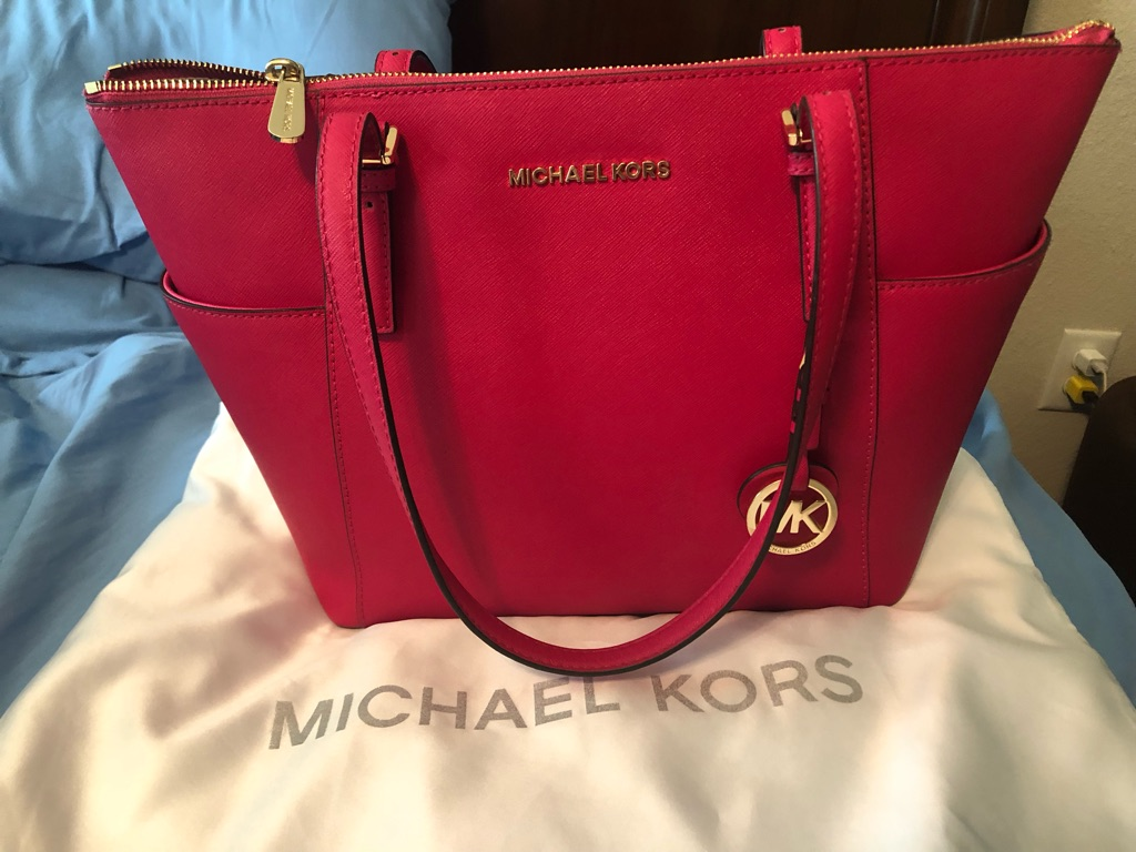 Authentic used pink Michael Kors purse