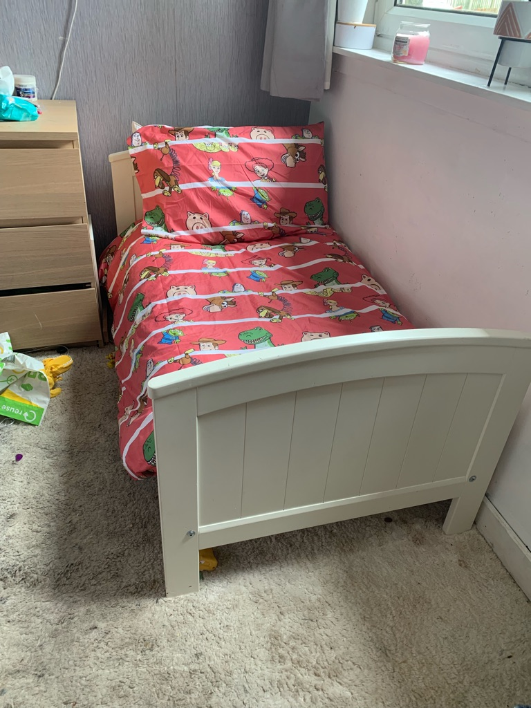 White wooden mamas and papas toddler bed