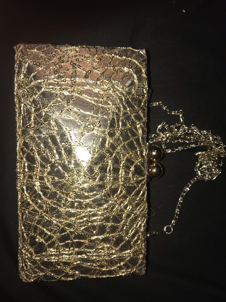 GOLD CLUTCH BAG WITH STRAP. £5