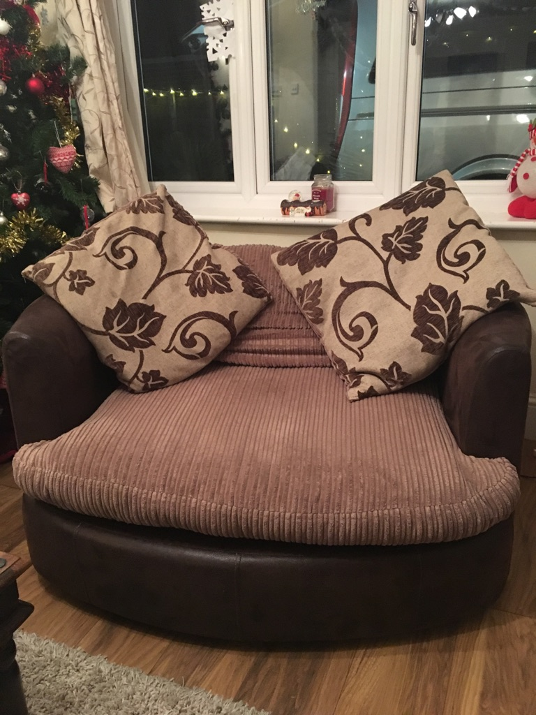Large brown swivel chair