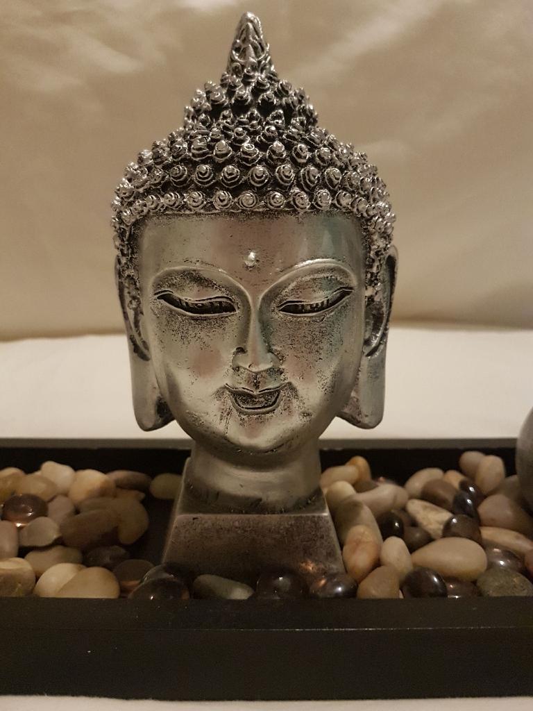 Buddah  sculpture in Zen tray