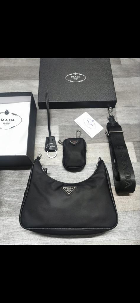 Women's brand New Prada handbag with small purse
