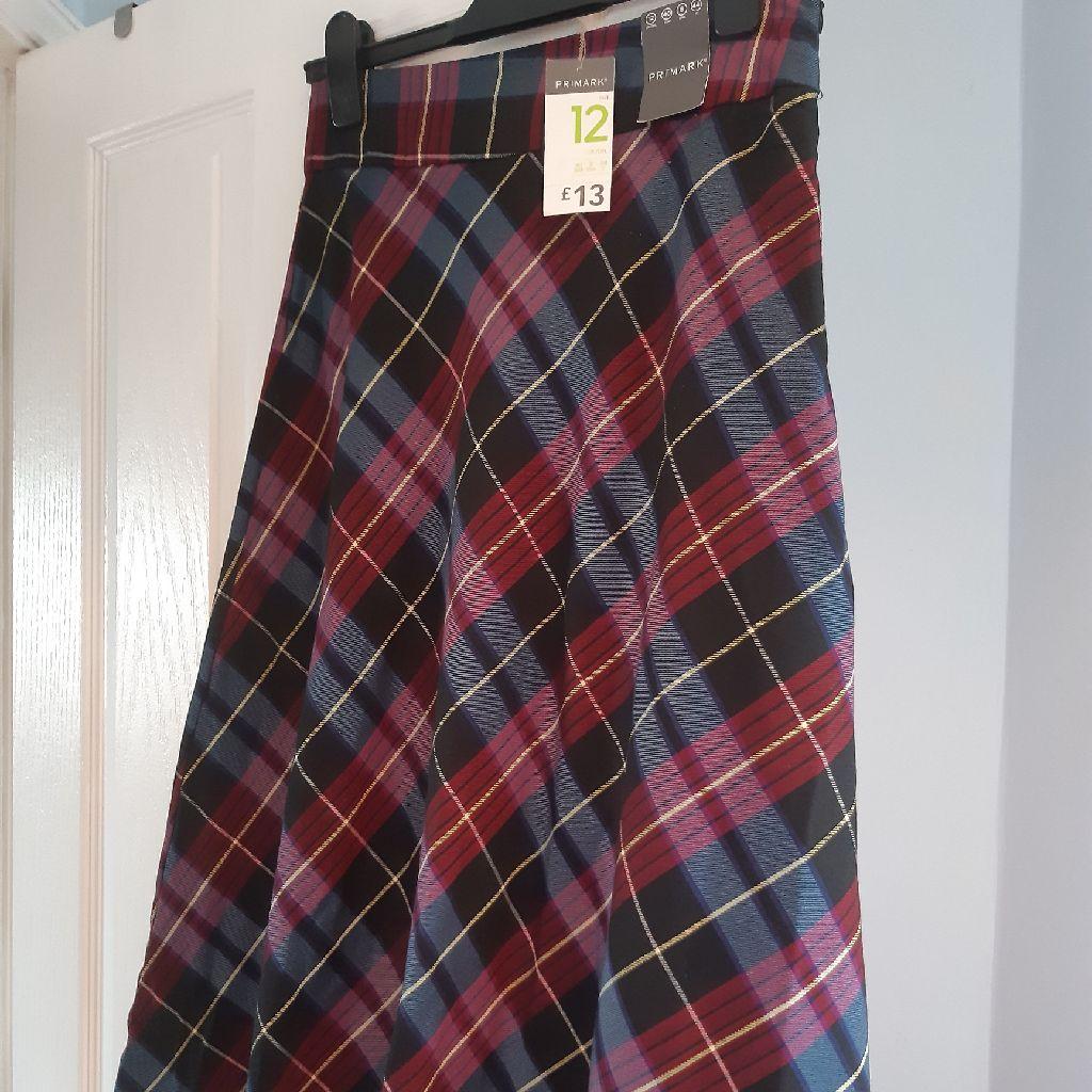 Below the knee plaid skirt