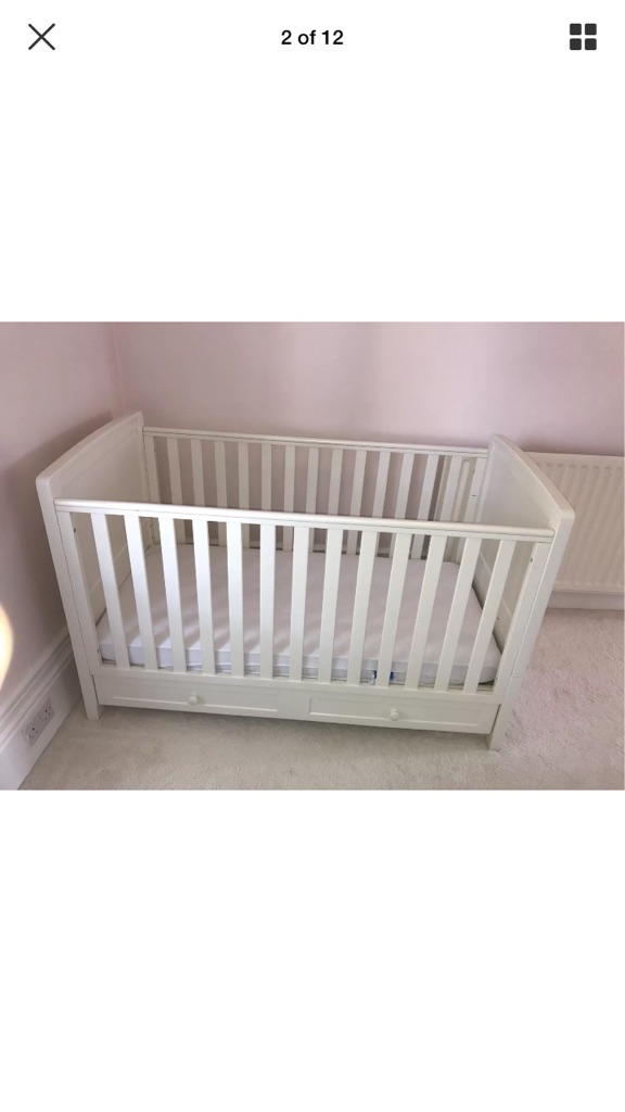 Silver across cot bed