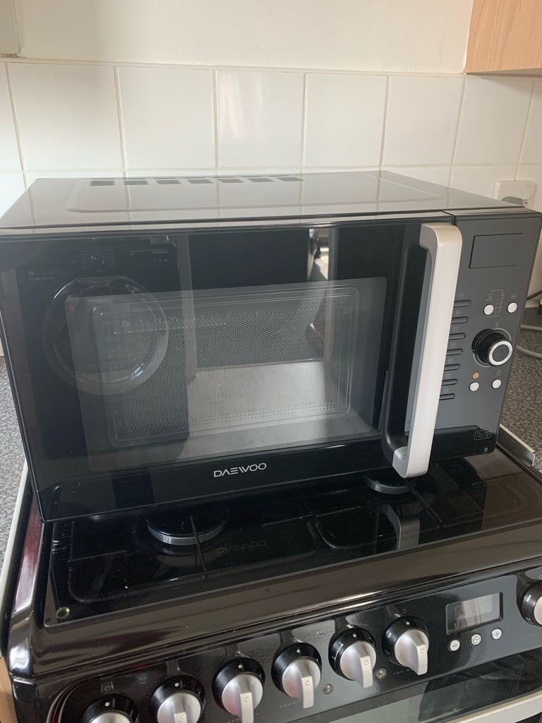 Black microwave oven and grill combi