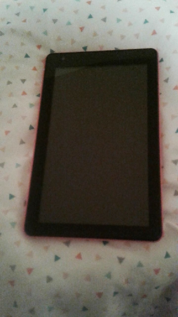 Pink RCA tablet with charger