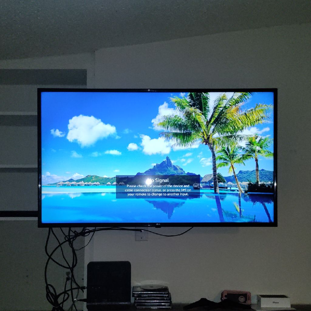 55' LG 4K UHD TV WITH REMOTE LEG STAND