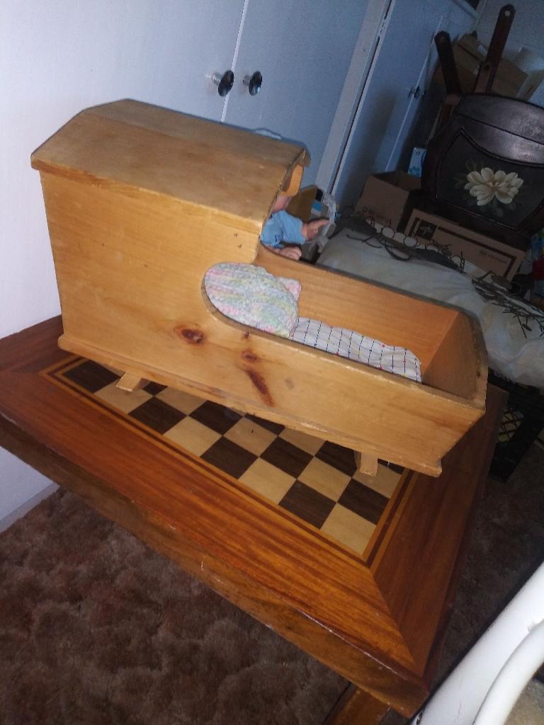 Handmade wooden dolls cradle
