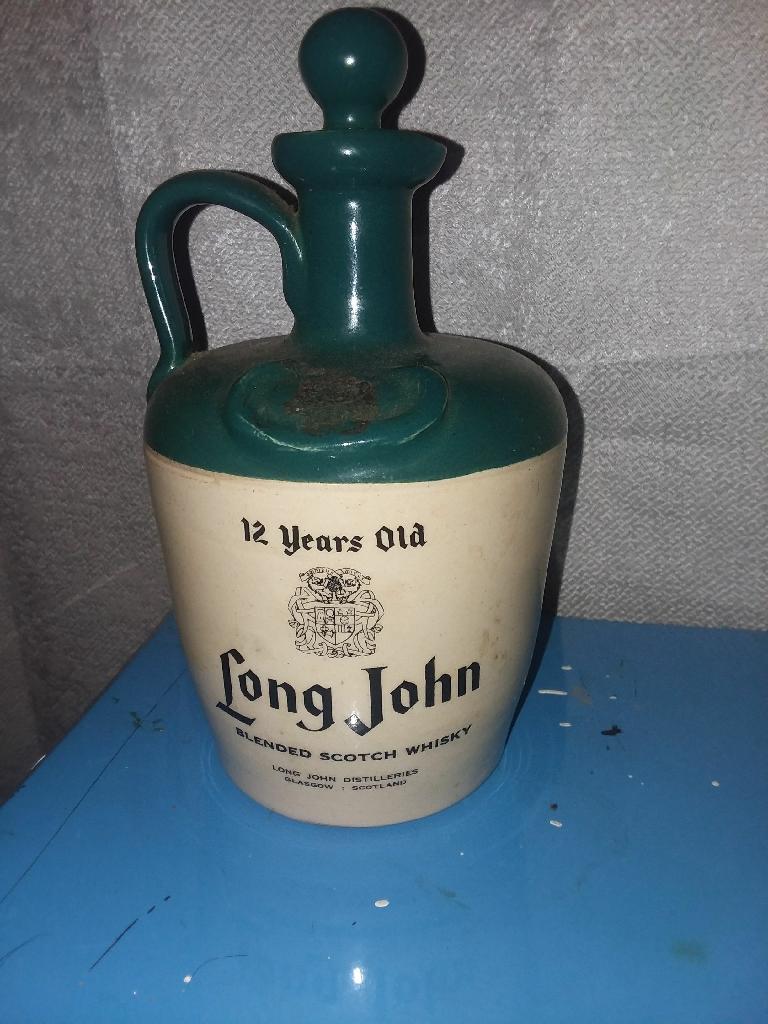vintage ceramic whiskey jug