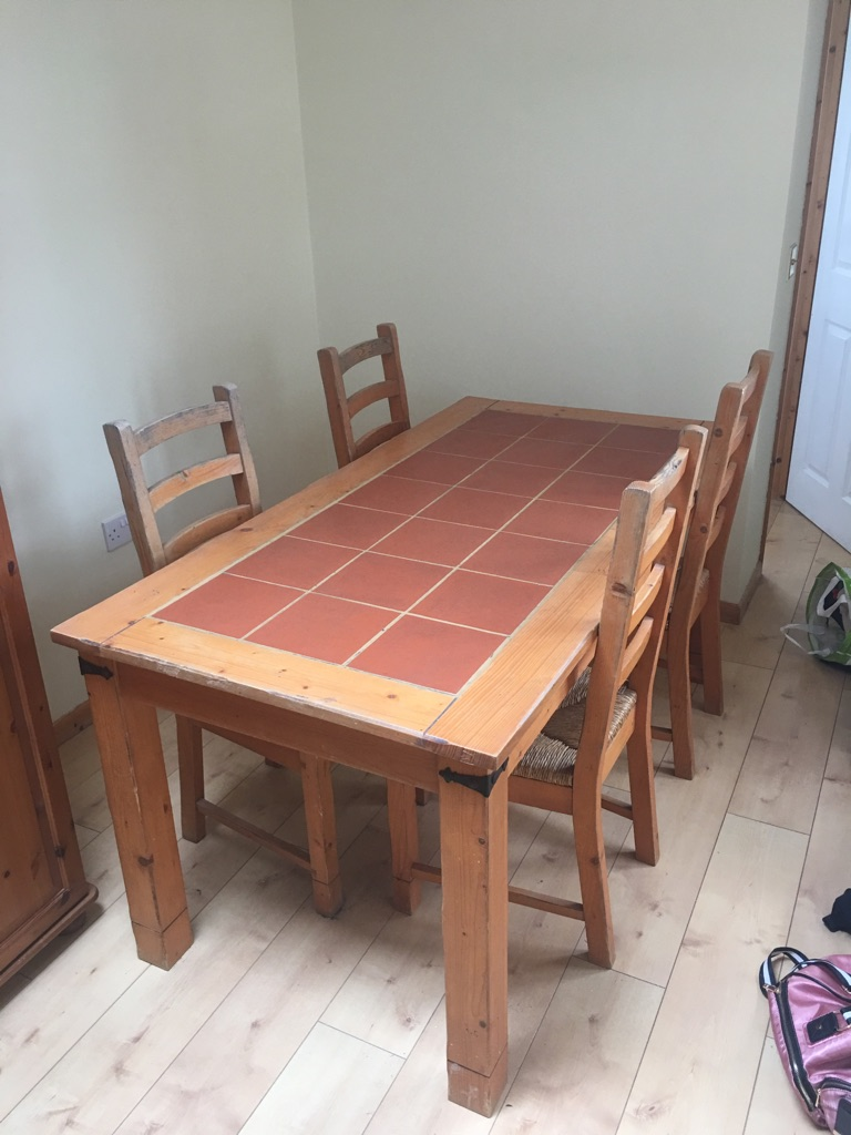 Pine dining table with terracotta surface and 4 dining chairs