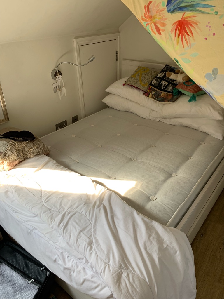 Double bed with mattress and storage