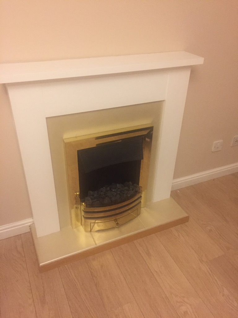 One piece electric fire and fireplace