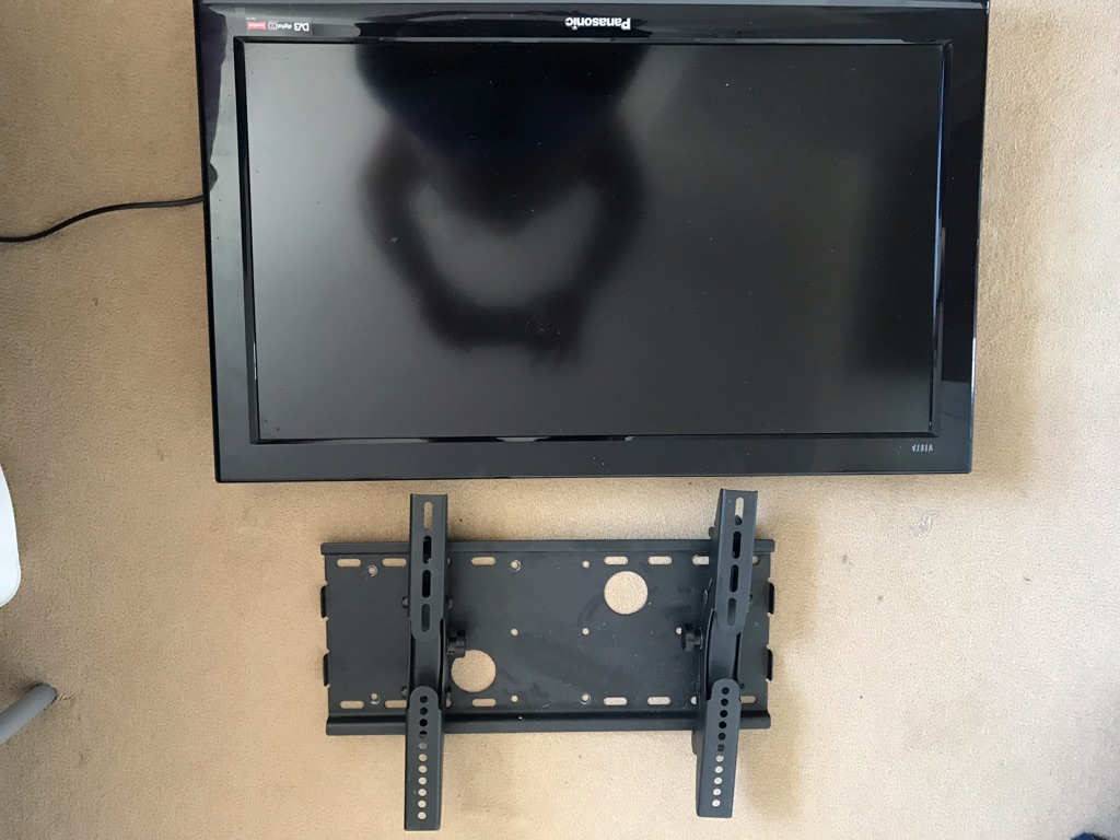 32 inch Panasonic TV with stand and walk bracket