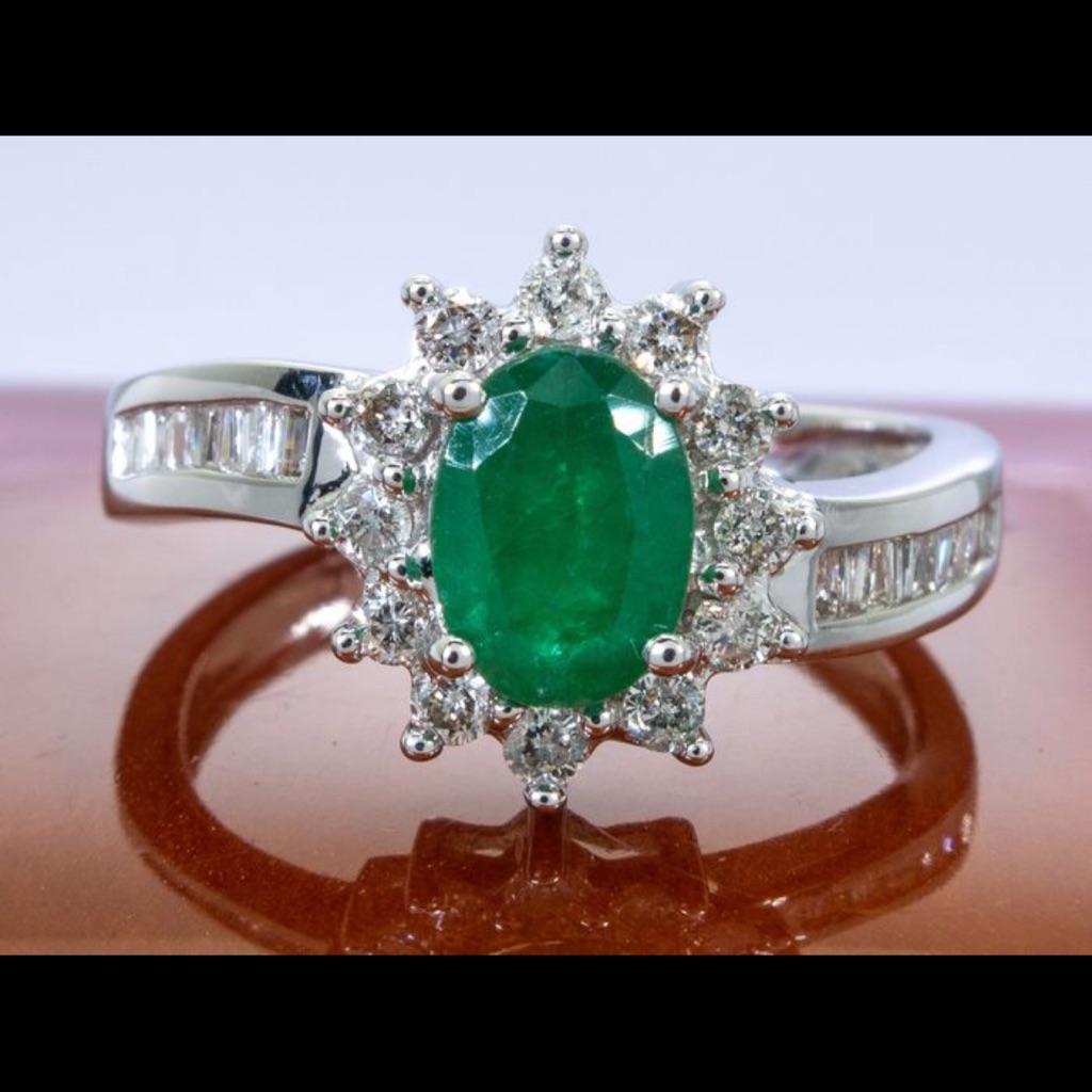14 karat white gold with diamonds and emerald