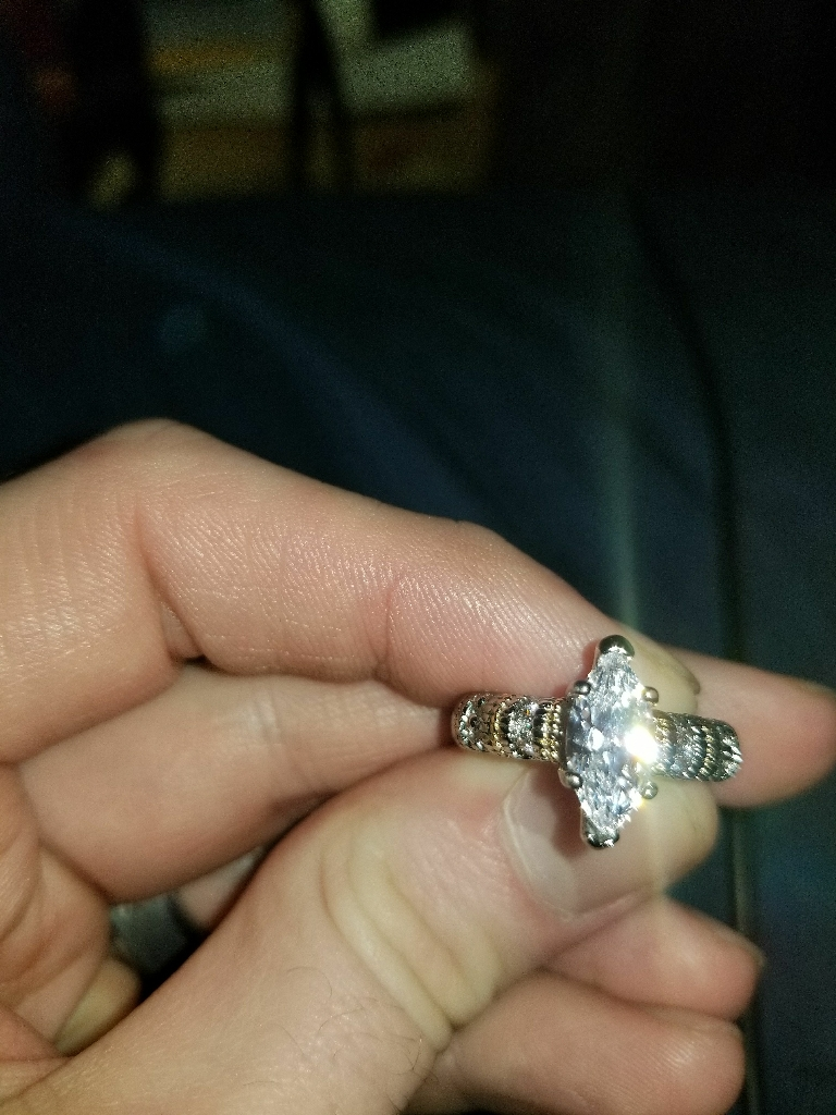 .925 Sterling silver and marquise cut synthetic diamond engagement ring