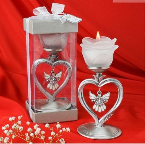 Angel designed rose candle holder with hanging ivory enamel angel