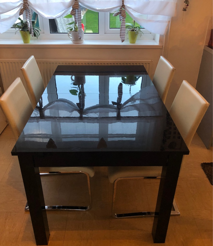 Next extendable dining table with 4 chairs