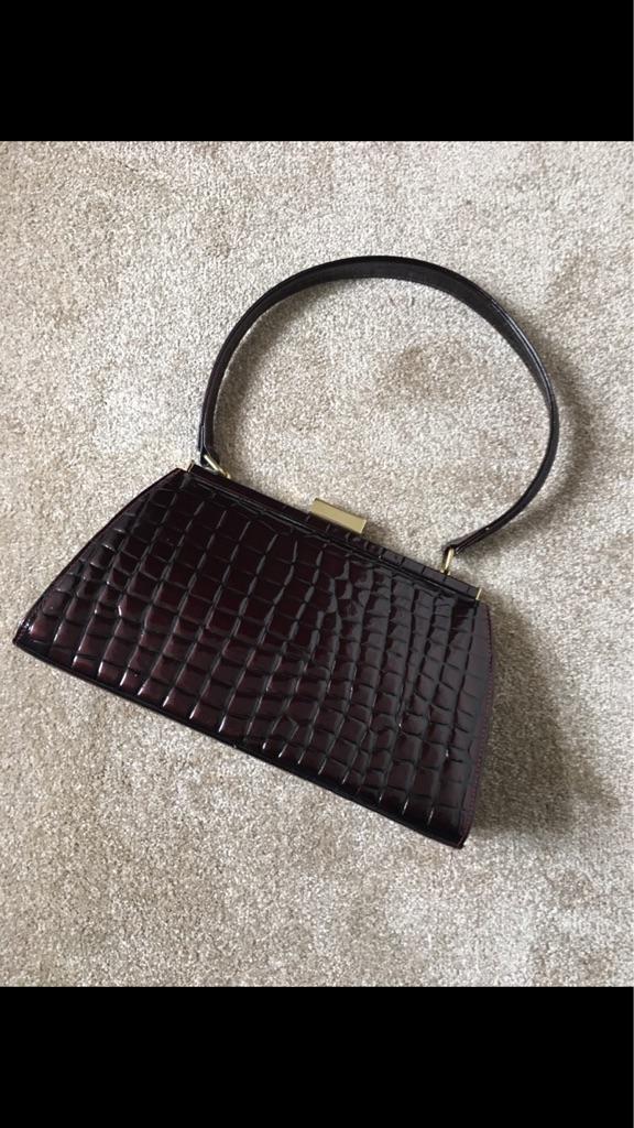 London Osprey clutch bag