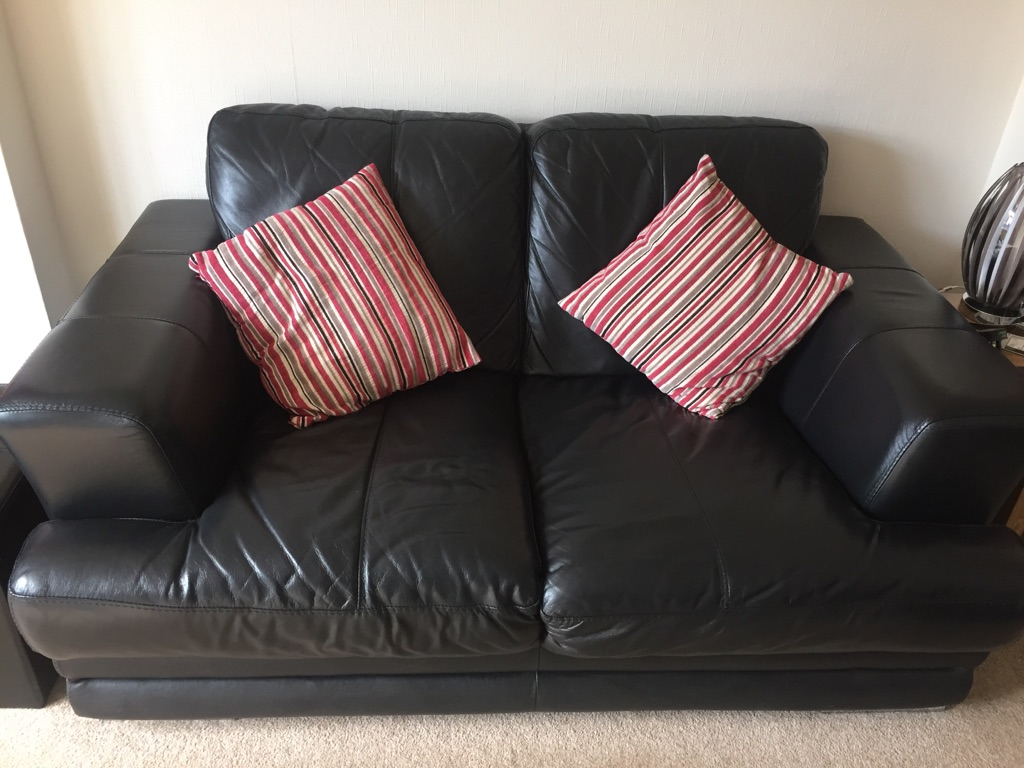 2 x Black leather two seater sofa